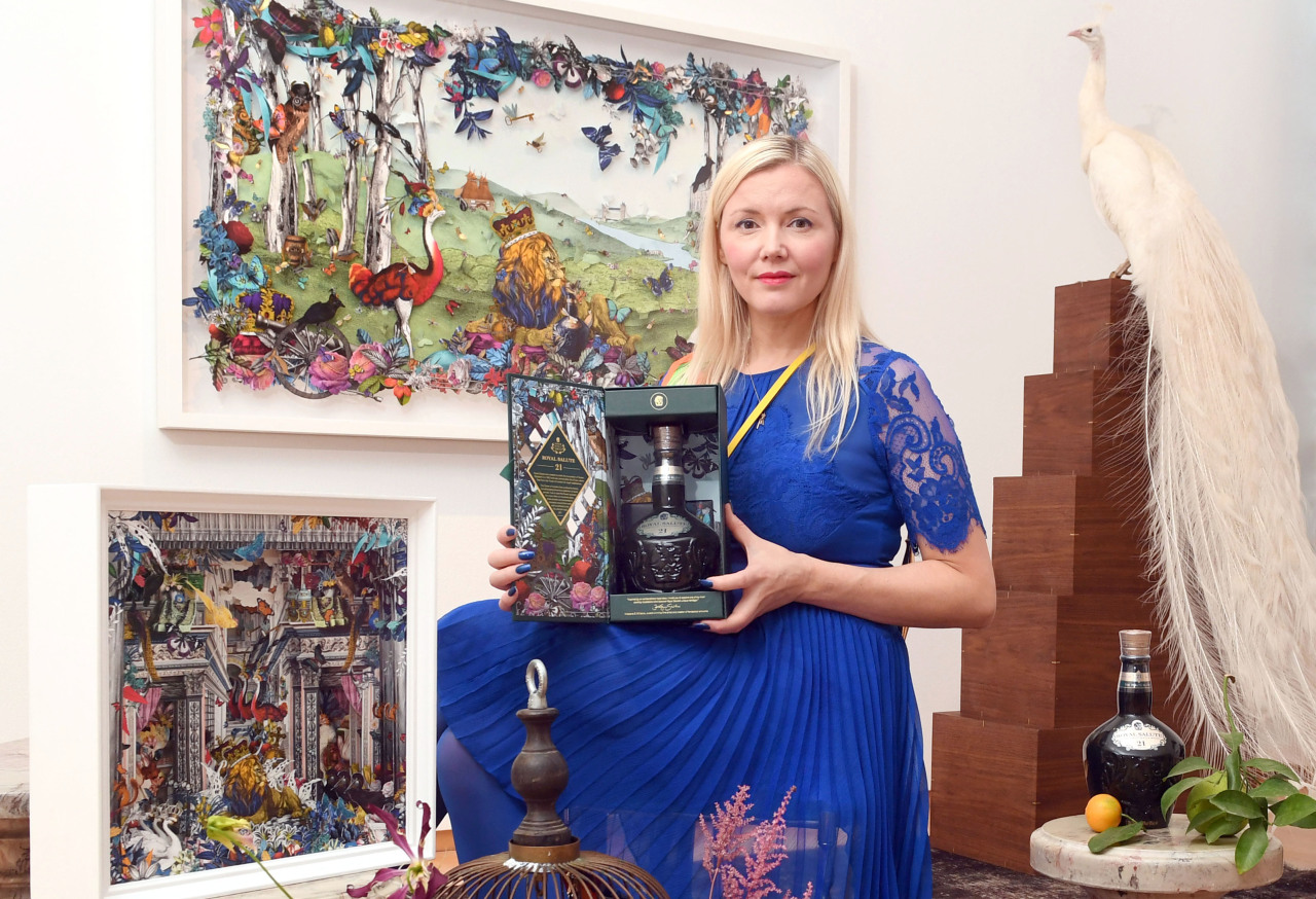 Icelandic artist Kristjana S. Williams poses with Royal Salute's signature 21 Year Old Scotch whisky at Gallery Planet in Apgujeong, Seoul, on Nov. 5. (Pernod Ricard Korea)