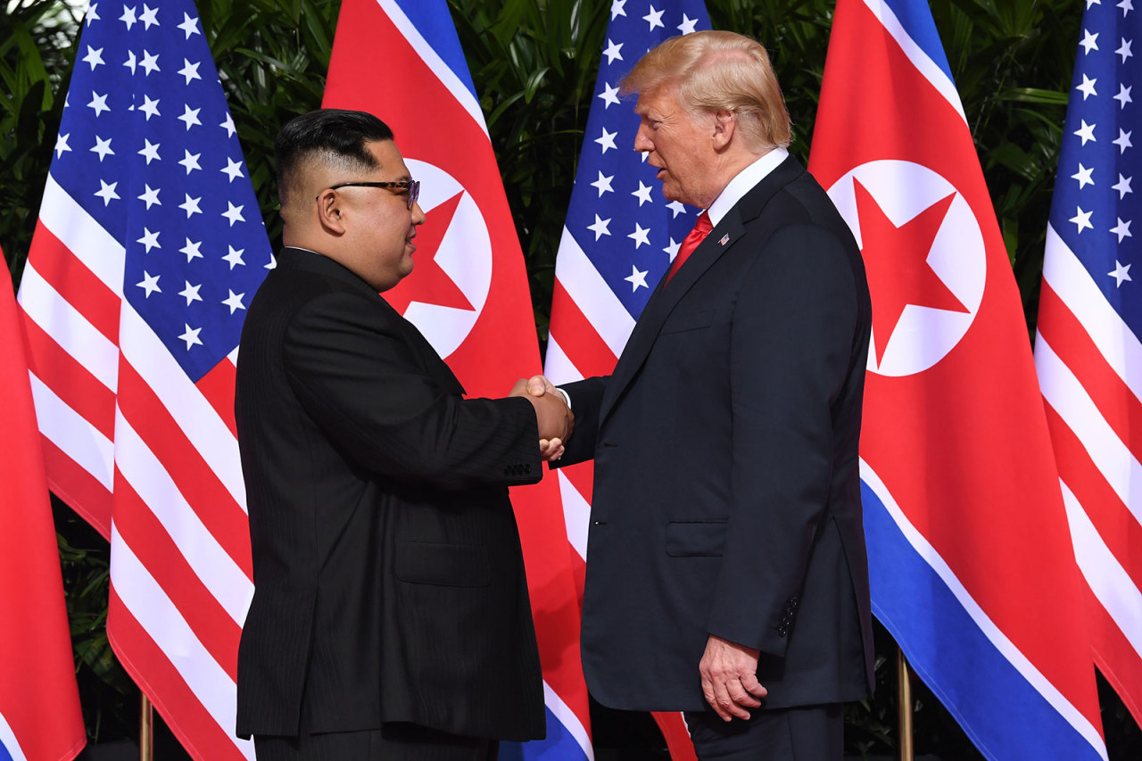 North Korean leader Kim Jong-un shakes hands with US President Donald Trump at the start of their summit in Singapore on June 12, 2018. (AFP)