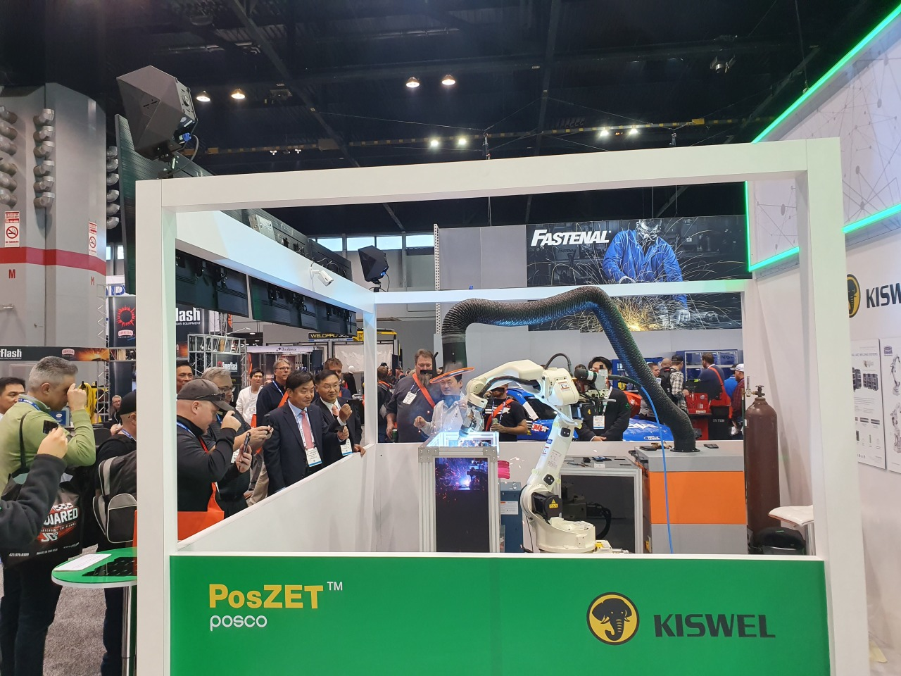 Visitors look at PosZET, an ultra-high strength steel plate welding solution for automobiles, developed by Posco and Kiswel, at Fabtech 2019 in Chicago on Nov. 11. (Posco)