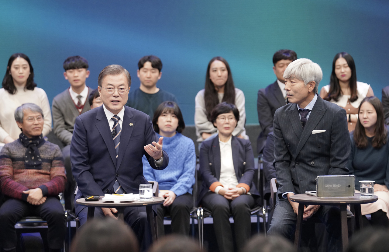 President Moon Jae-in speaks during the televised meeting on Tuesday. Yonhap
