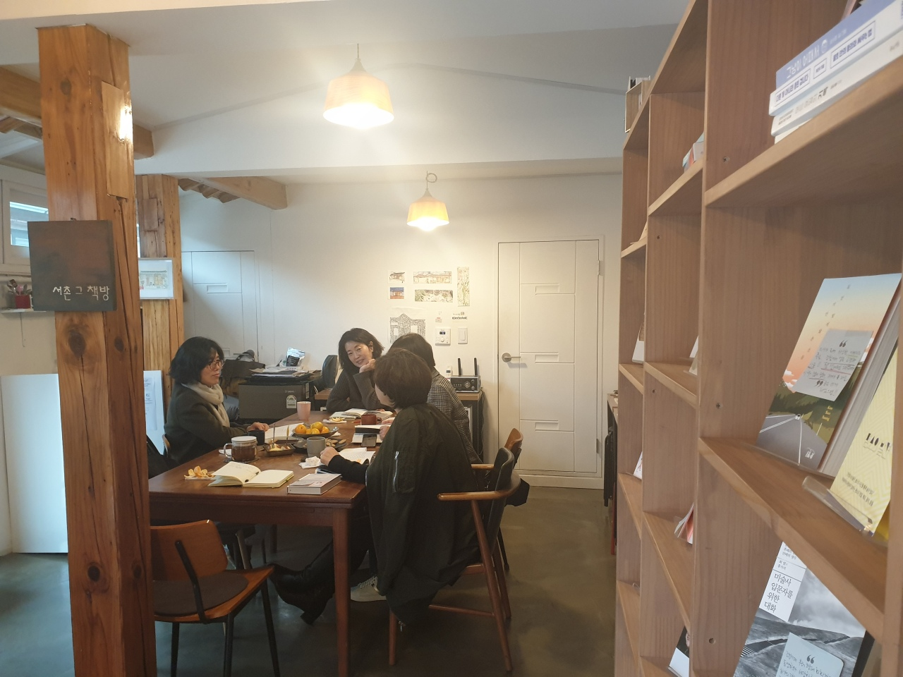 People gather at SeochonBooks to discuss books they've read over the past month. (Park Yuna/The Korea Herald)