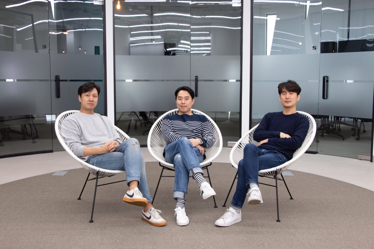 From left: Aionco Korea Director Nam Gun-woo, CEO Justin Jun and Chief Technology Officer Seo Mun-kyo pose inside the Seoul office. (Aionco Korea)