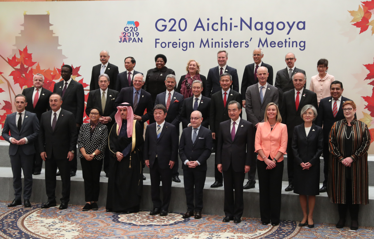 South Korean Foreign Minister Kang Kyung-wha (front row, second from right) and Japanese counterpart Toshimitsu Motegi (front row, fifth from left) on Saturday pose for official photograph at the Group of 20 ministerial summit held in Nagoya, Japan. (Yonhap)