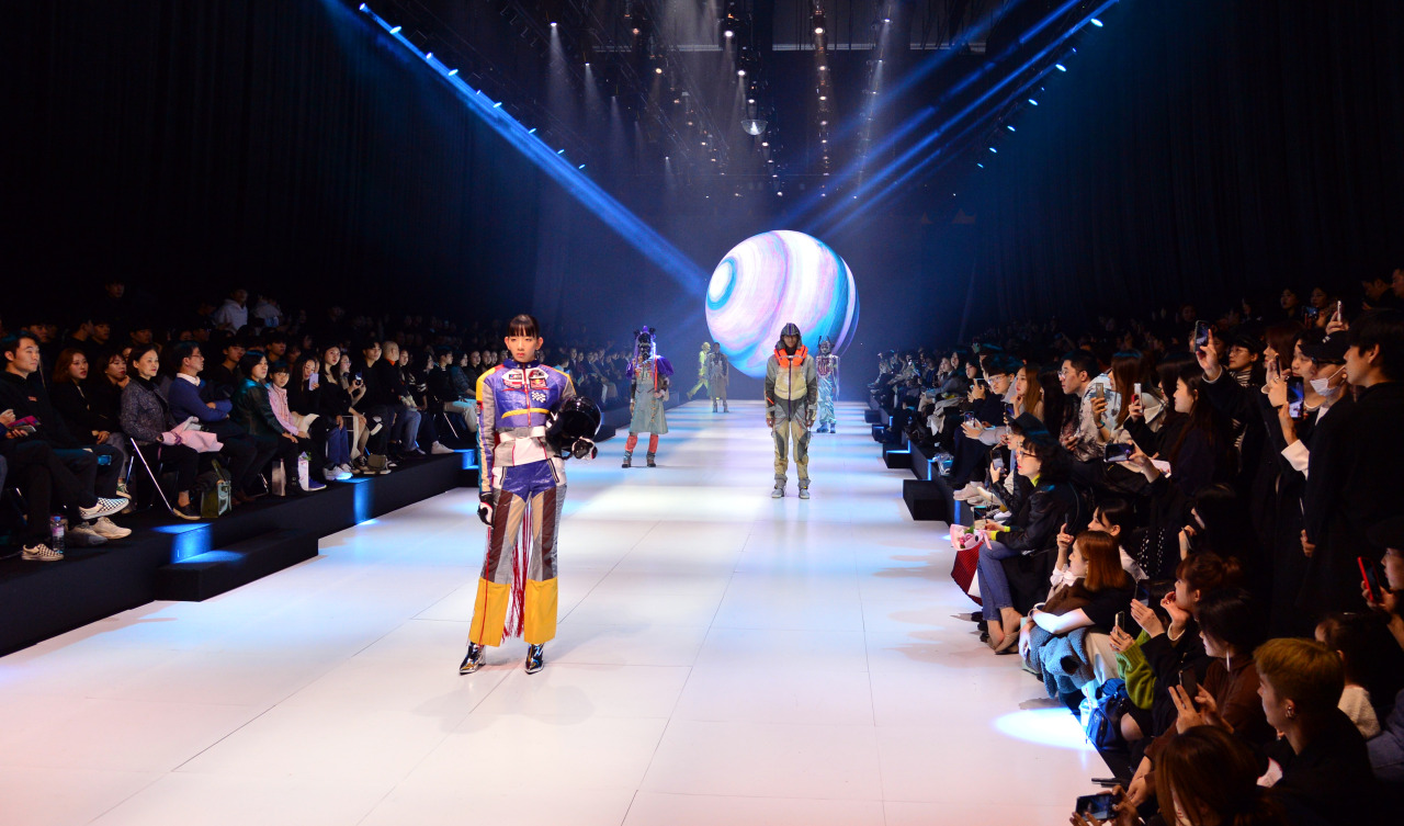 Models pose on the runway wearing creations made by local university students who study fashion design, at Bexco Auditorium in Busan on Sunday. (Park Hyun-koo / The Korea Herald)