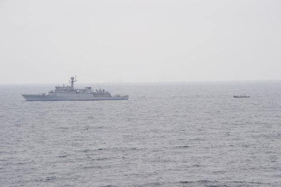 South Korean naval ship tows a North Korean boat 5 kilometers below the Northern Limit Line in the East Sea on June 11. (Joint Chiefs of Staff)
