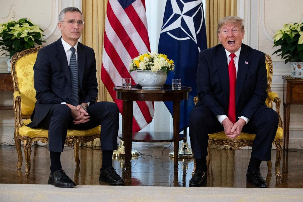 US President Donald Trump speaks during a meeting with NATO Secretary General, Jens Stoltenberg at Winfield House in London, Tuesday, Dec. 3, 2019. US President Donald Trump will join other NATO heads of state at Buckingham Palace in London on Tuesday to mark the NATO Alliance's 70th birthday. (AP)