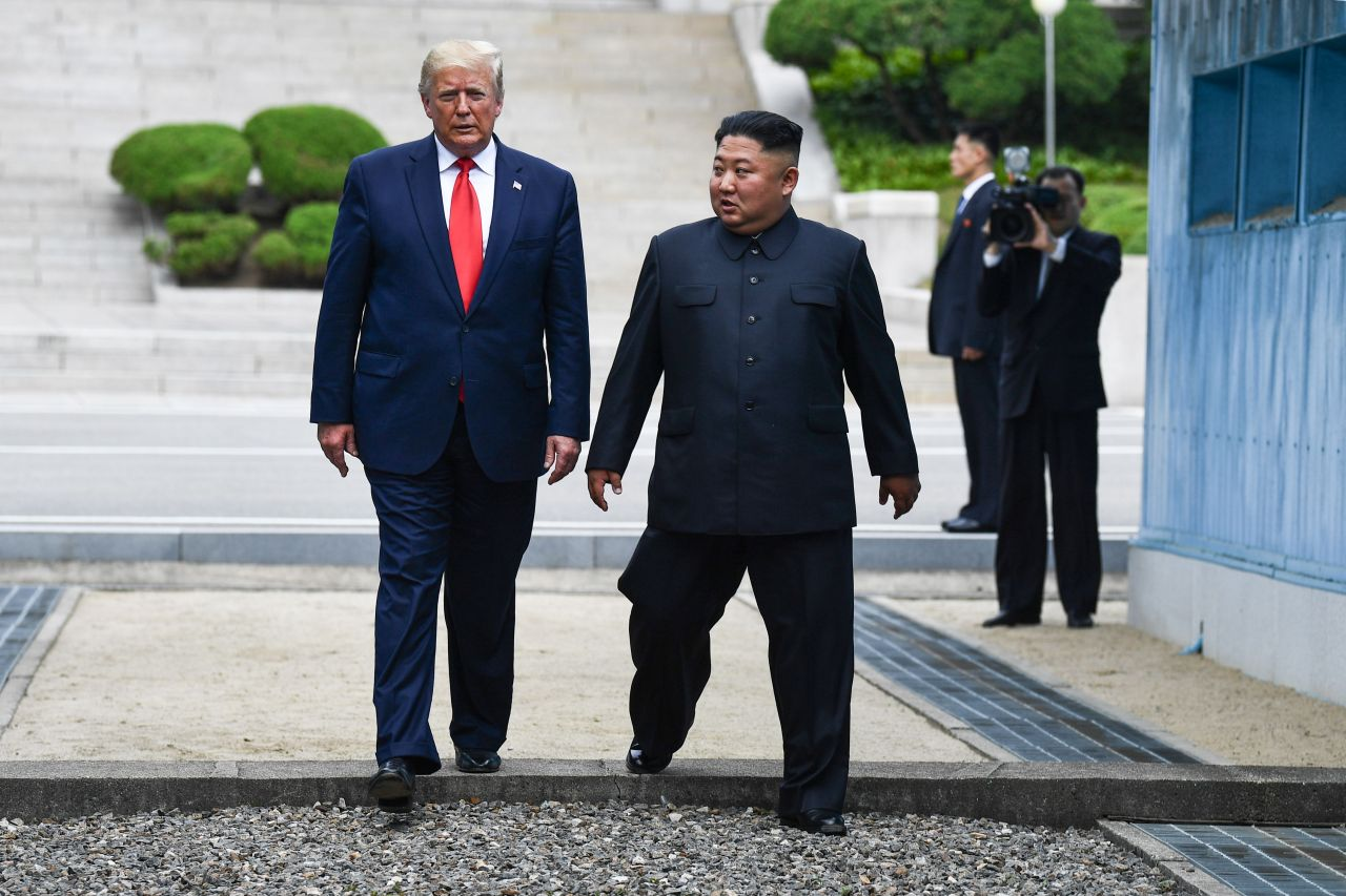 In this file photo taken on June 30, 2019 North Korea's leader Kim Jong-un and US President Donald Trump cross south of the Military Demarcation Line that divides North and South Korea, after Trump briefly stepped over to the northern side, in the Joint Security Area (JSA) of Panmunjom in the Demilitarized zone (DMZ). (AFP-Yonhap)