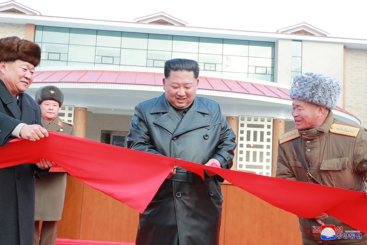 North Korean leader Kim Jong Un cuts a ribbon during a ceremony for the completion of the Yangdok County Hot Spring Cultural Recreation Center in North Korea in this undated picture released by North Korea's Central News Agency (KCNA) on Dec. 7. (KCNA)