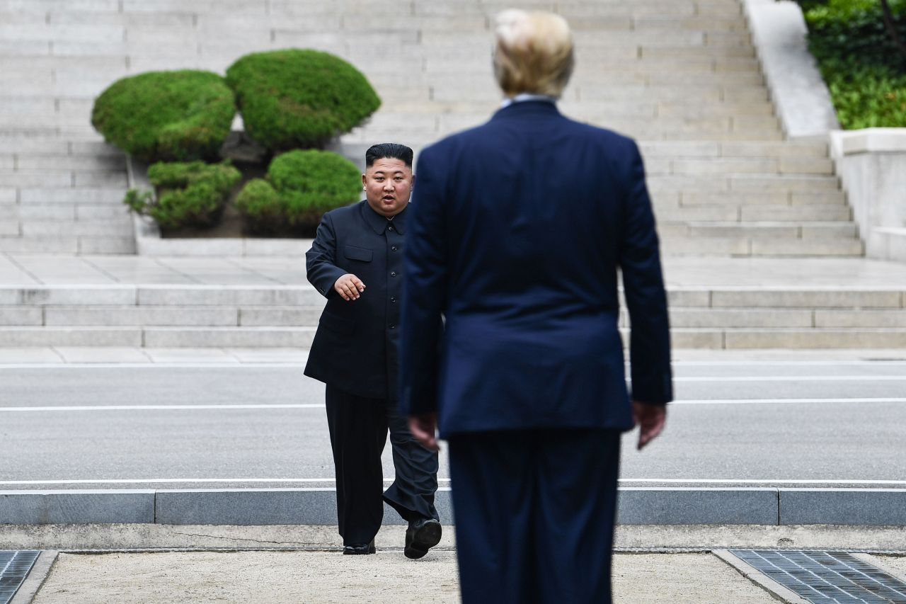 In this file photo taken on June 30, North Korea's leader Kim Jong-un walks to greet US President Donald Trump at the Military Demarcation Line that divides North and South Korea, in the Joint Security Area of Panmunjom in the Demilitarized zone. (AFP-Yonhap)