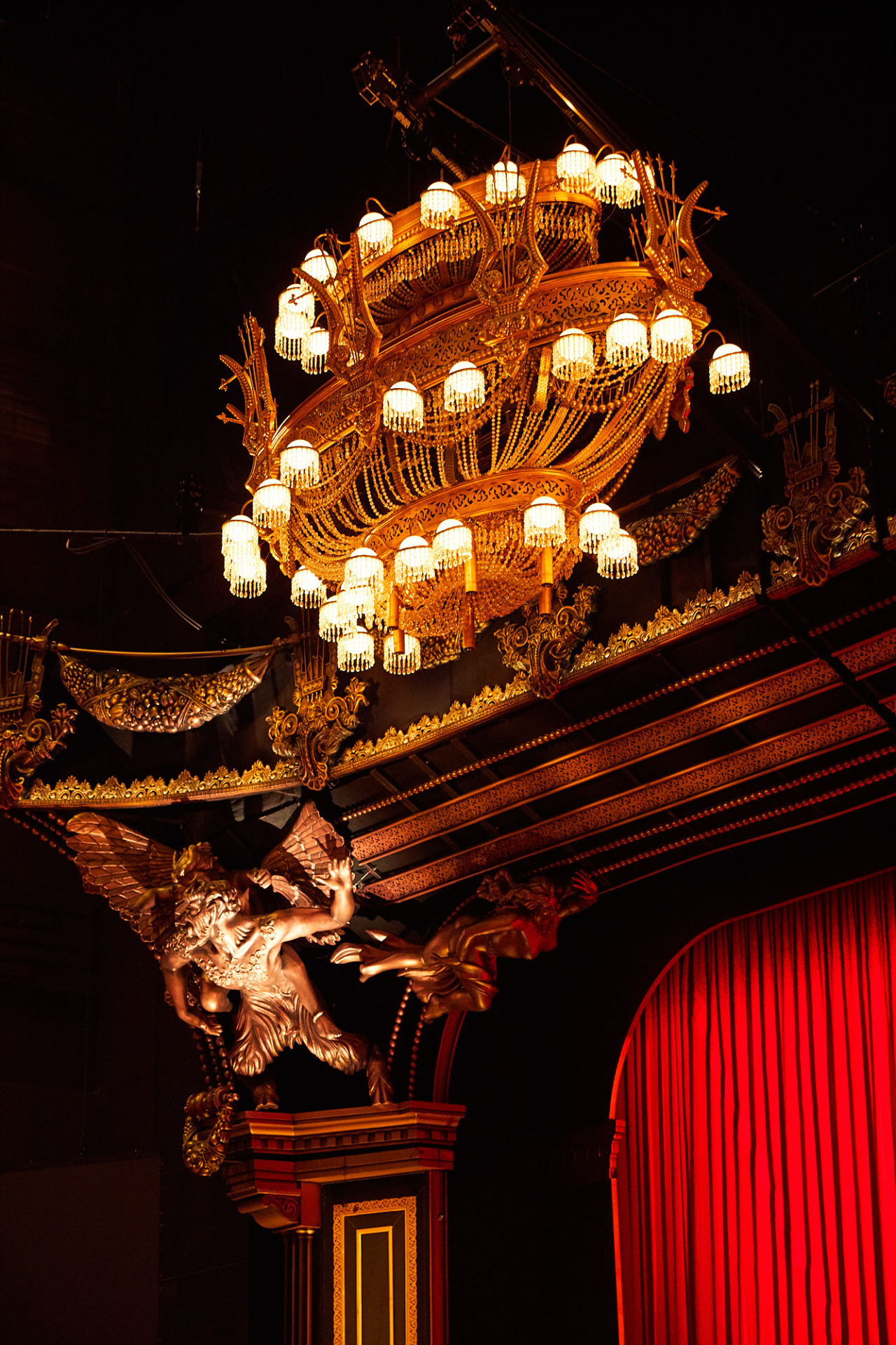The chandelier is suspended by two cables, hanging above the front raw of the audience. It crashes down on to the stage, signaling the phantom's anger. (S&Co)
