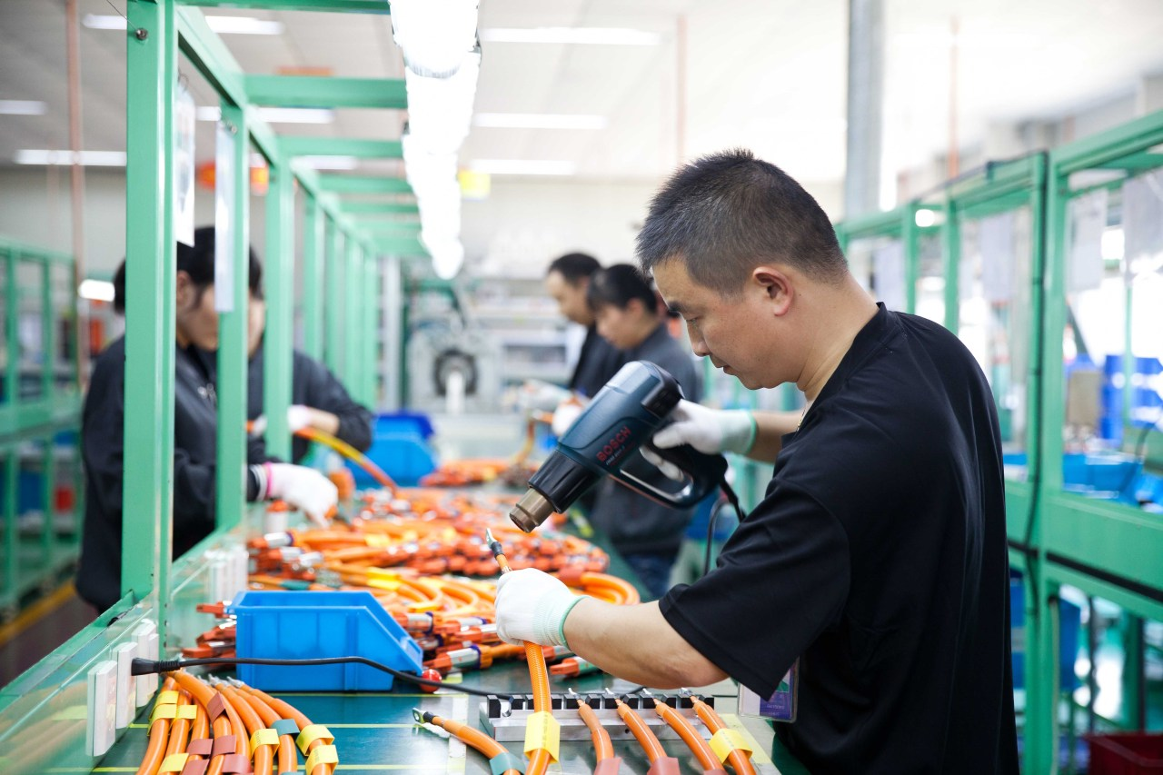An employee assembles a high-voltage harness at a plant of LS EV Korea in China. (LS Cable & System)