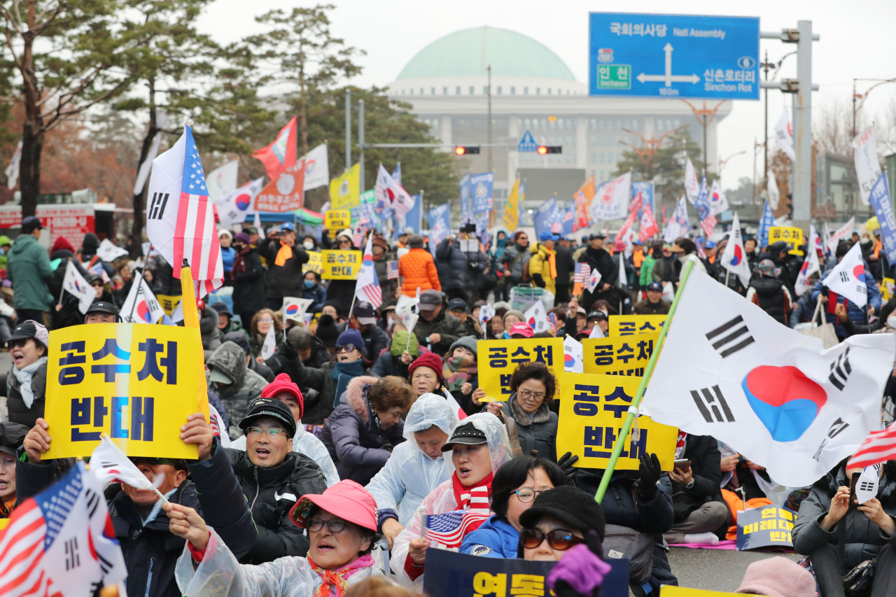 Conservative activists hold a rally in front of the National Assembly in Seoul on Tuesday. (Yonhap)