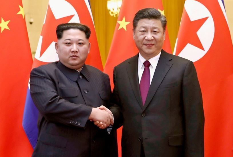 North Korean leader Kim Jong-un (left) and Chinese President Xi Jinping (AP)