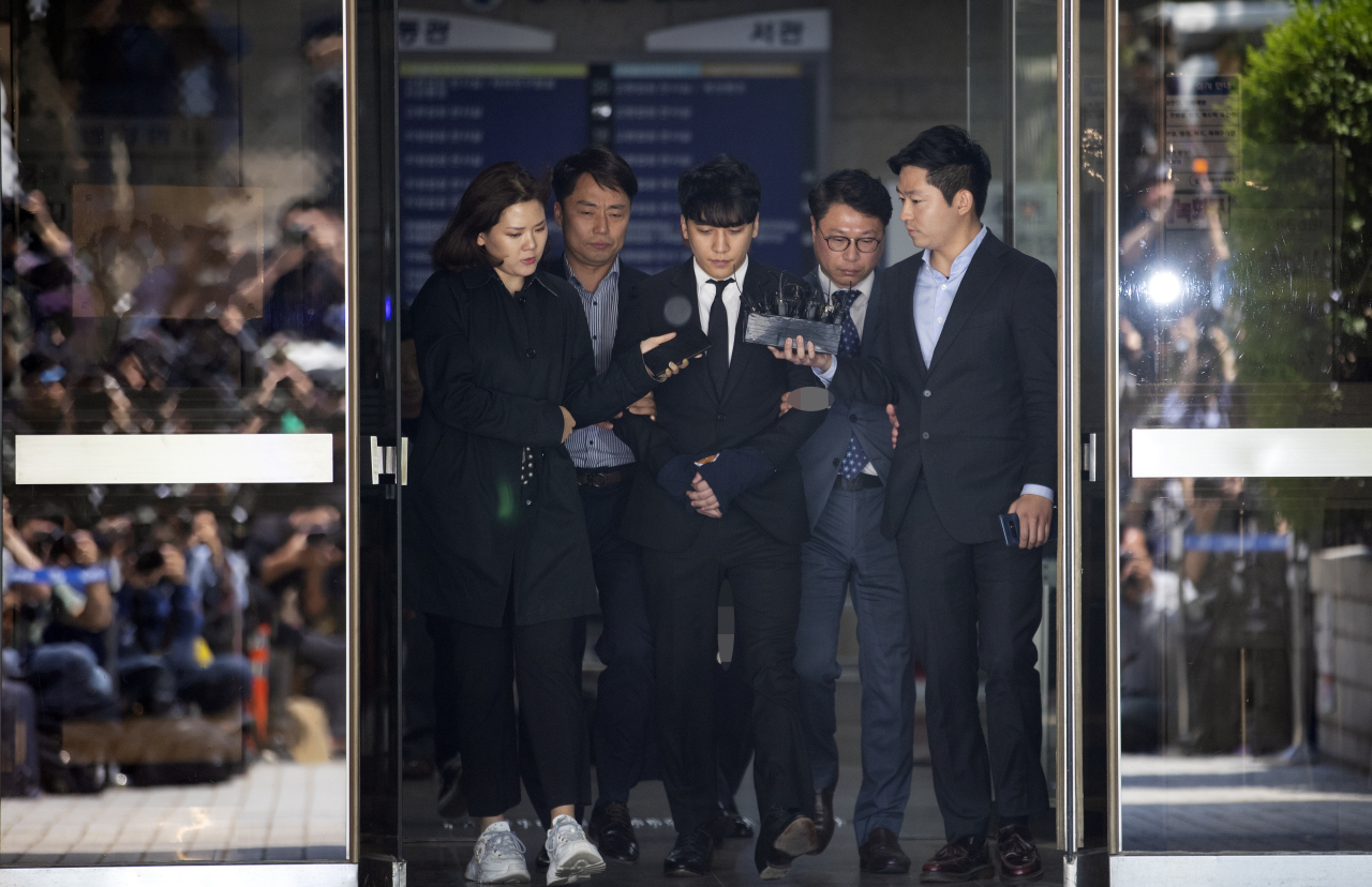 Seungri, former Big Bang member, in May attends arrest warrant hearing on charges of embezzlement and procuring sexual services. The court denied to issue an arrest warrant. (Yonhap)