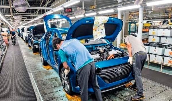 Hyundai Motor workers are seen at the automaker's Ulsan plant. Hyundai Motor