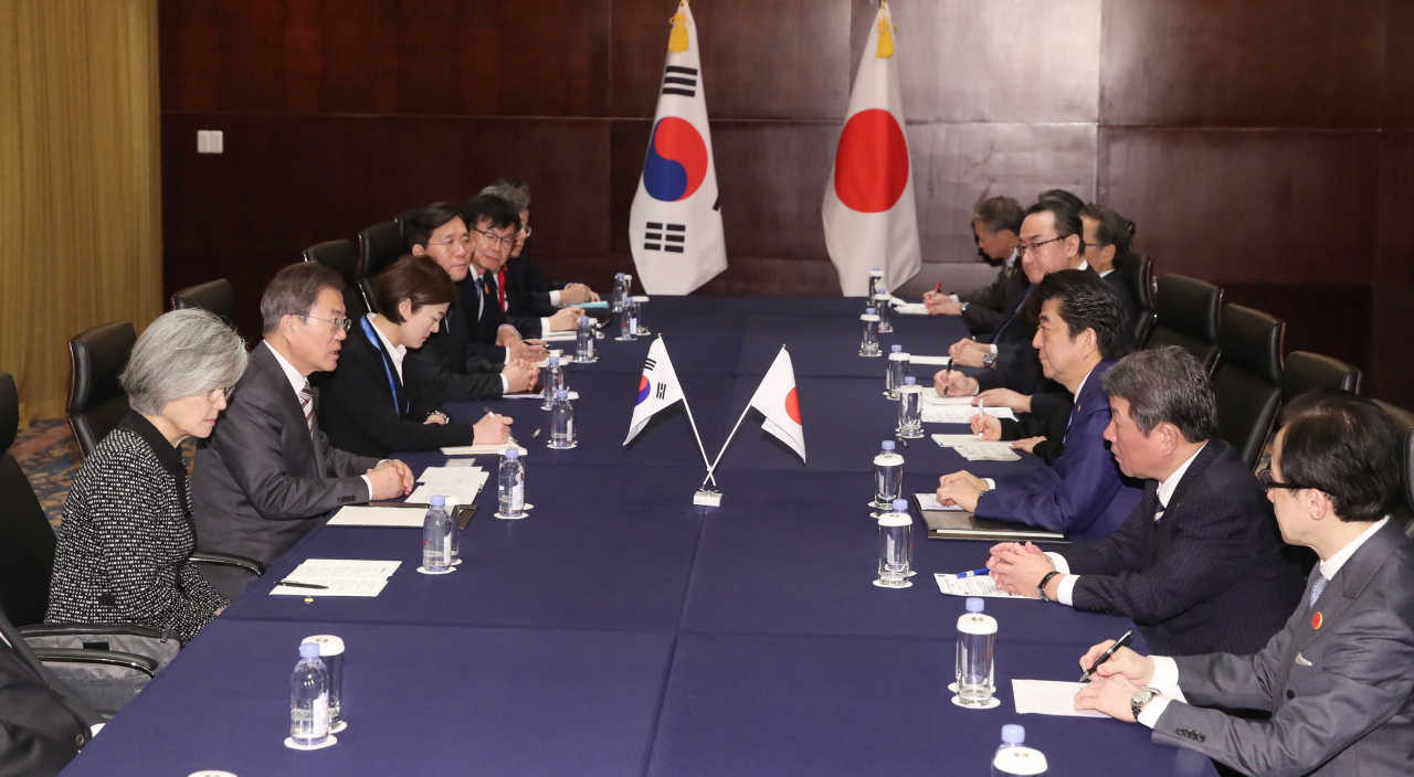 South Korean President Moon Jae-in speaks during the summit with Japanese Prime Minister Shinzo Abe at a hotel in Chengdu, China, on Tuesday. (Yonhap)