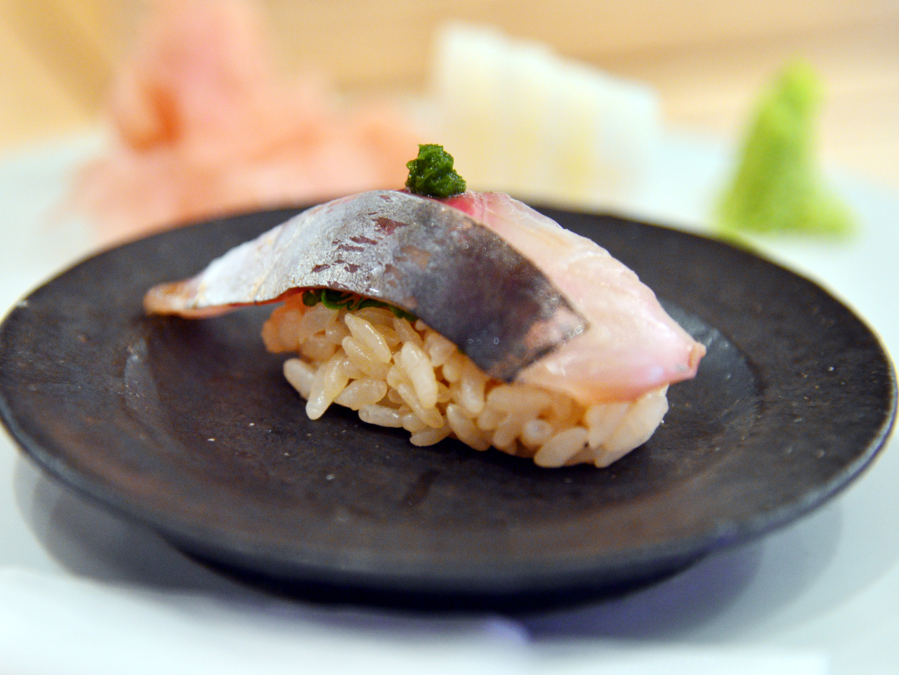 Sushi Sakau's aji -- horse mackerel -- is heightened by fragrant shiso and a scallion paste that derives its notable flavor from a specific vinegar (Park Hyun-koo/The Korea Herald)