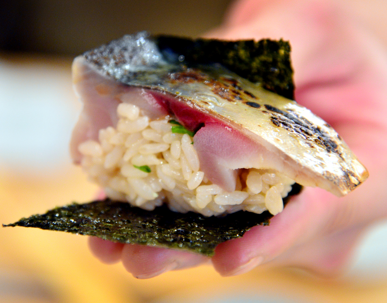 Sushi Sakau's toothsome and hefty saba -- mackerel --is served swadled in lacquered dried laver (Park Hyun-koo/The Korea Herald)