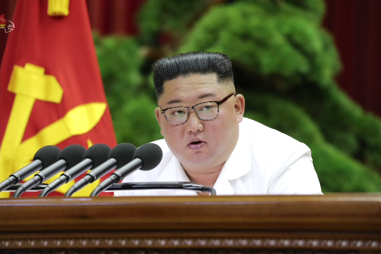 North Korean leader Kim Jong-un is seen speaking at the party`s plenary meeting on Sunday in an image released by the Korean Central News Agency. Yonhap