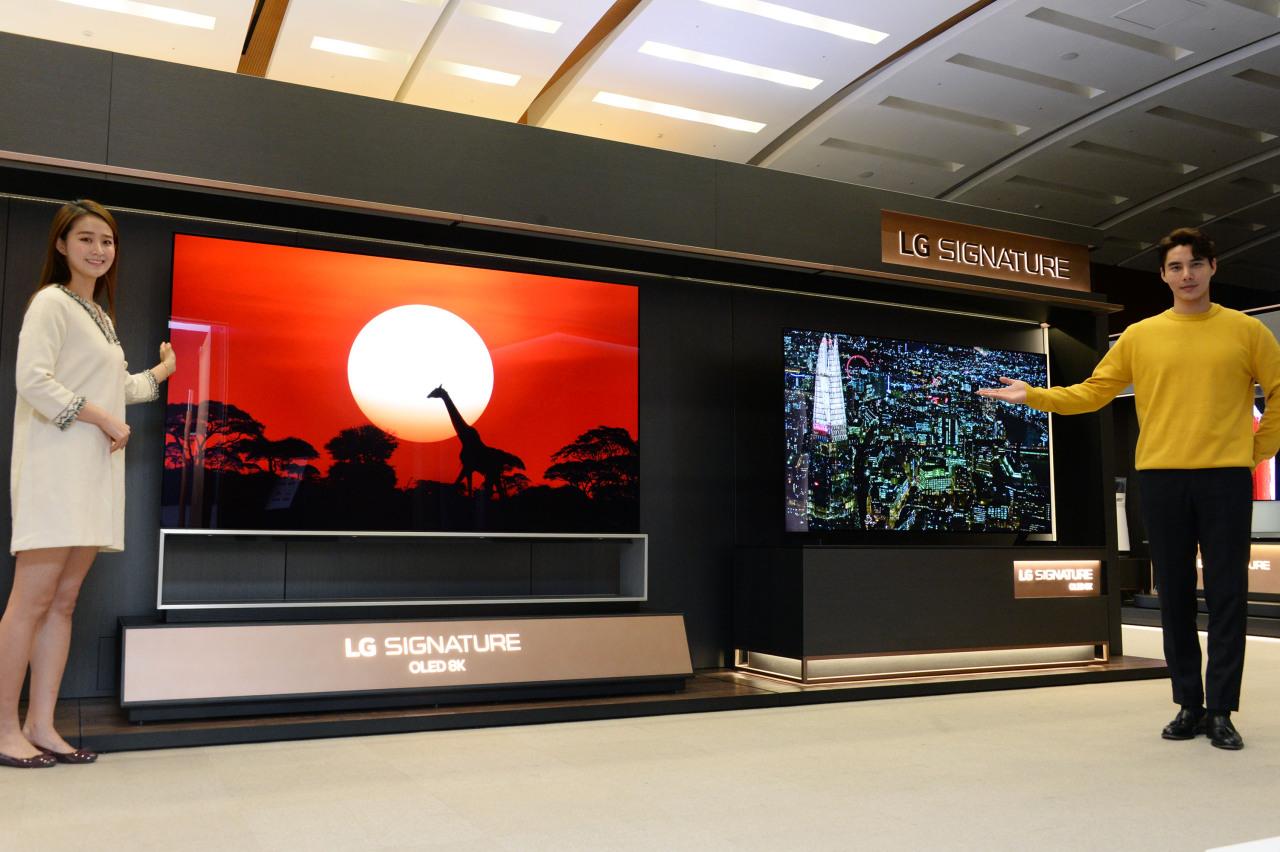 Employees showcase a new OLED 8K model. (LG Electronics)