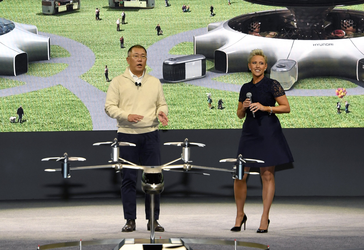 Hyundai Motor Group Executive Vice Chairman Chung Euisun (left) speaks during a media event held at Consumer Electronics Show 2020 in Las Vegas, Monday. (Hyundai Motor Group)