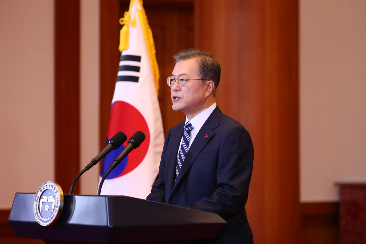 President Moon Jae-in delivers the New Year address on Tuesday. Yonhap