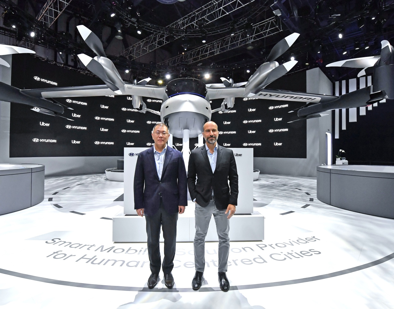 Hyundai Motor Group Executive Vice Chairman Chung Euisun (left) and Uber CEO Dara Khosrowshahi pose for a photo after signing a partnership at Consumer Electronics Show 2020 in Las Vegas on Tuesday. Hyundai Motor Group