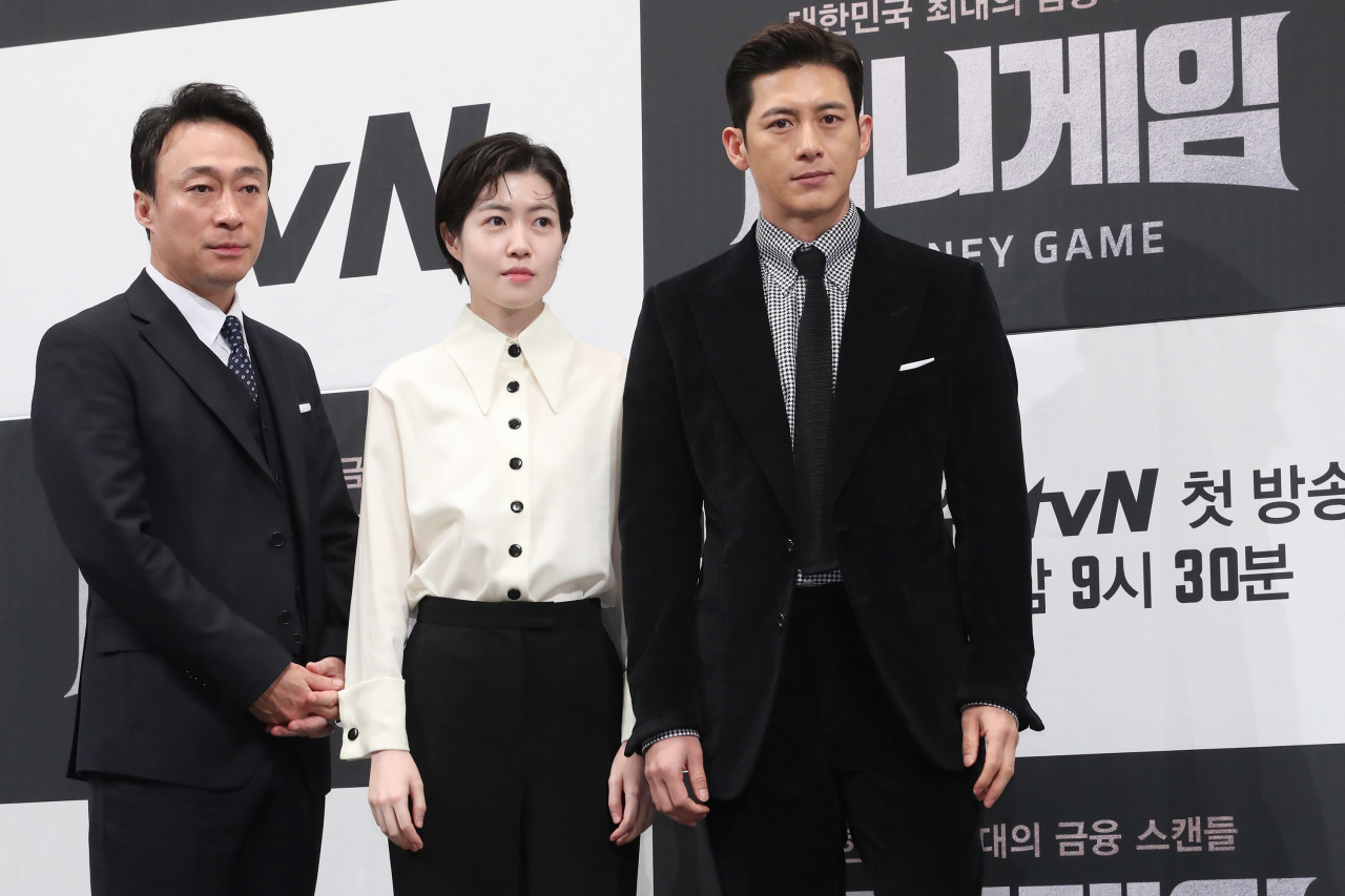 "(From left) Lee Sung-min, Shim Eun-kyung and Go Soo pose for pictures during a media event for ""Money Game,"" in Seoul on Wednesday. (Yonhap)"