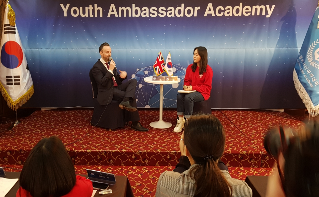 Stephen Burns (left), head of media and public affairs at the British Embassy in Seoul, speaks at the annual 2020 Youth Ambassador Camp organized by Korean Culture Association in southeastern Seoul on Friday. (British Embassy in Korea)