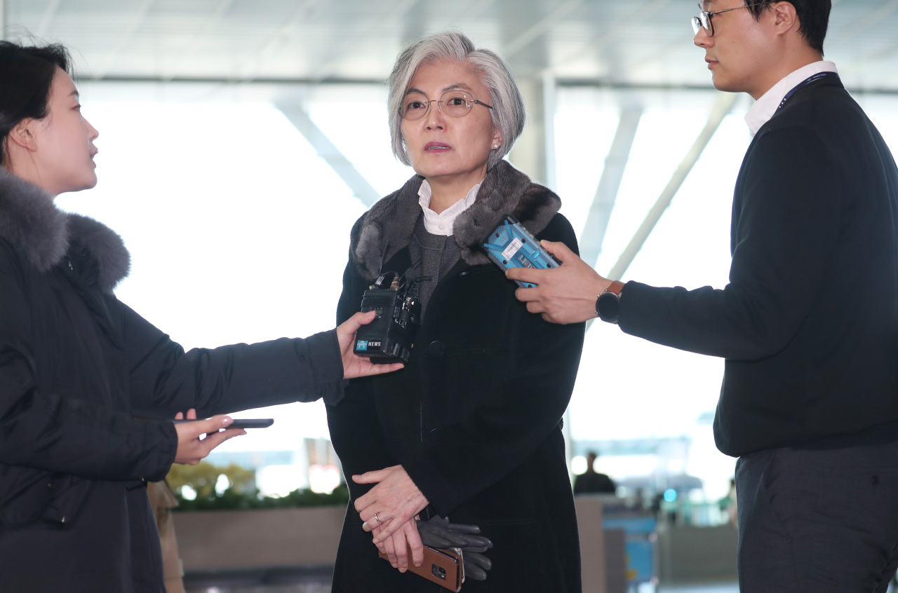 South Korea`s Foreign Minister Kang Kyung-wha answers questions by the reporters at Incheon International Airport on Monday, before heading to US. (Yonhap)