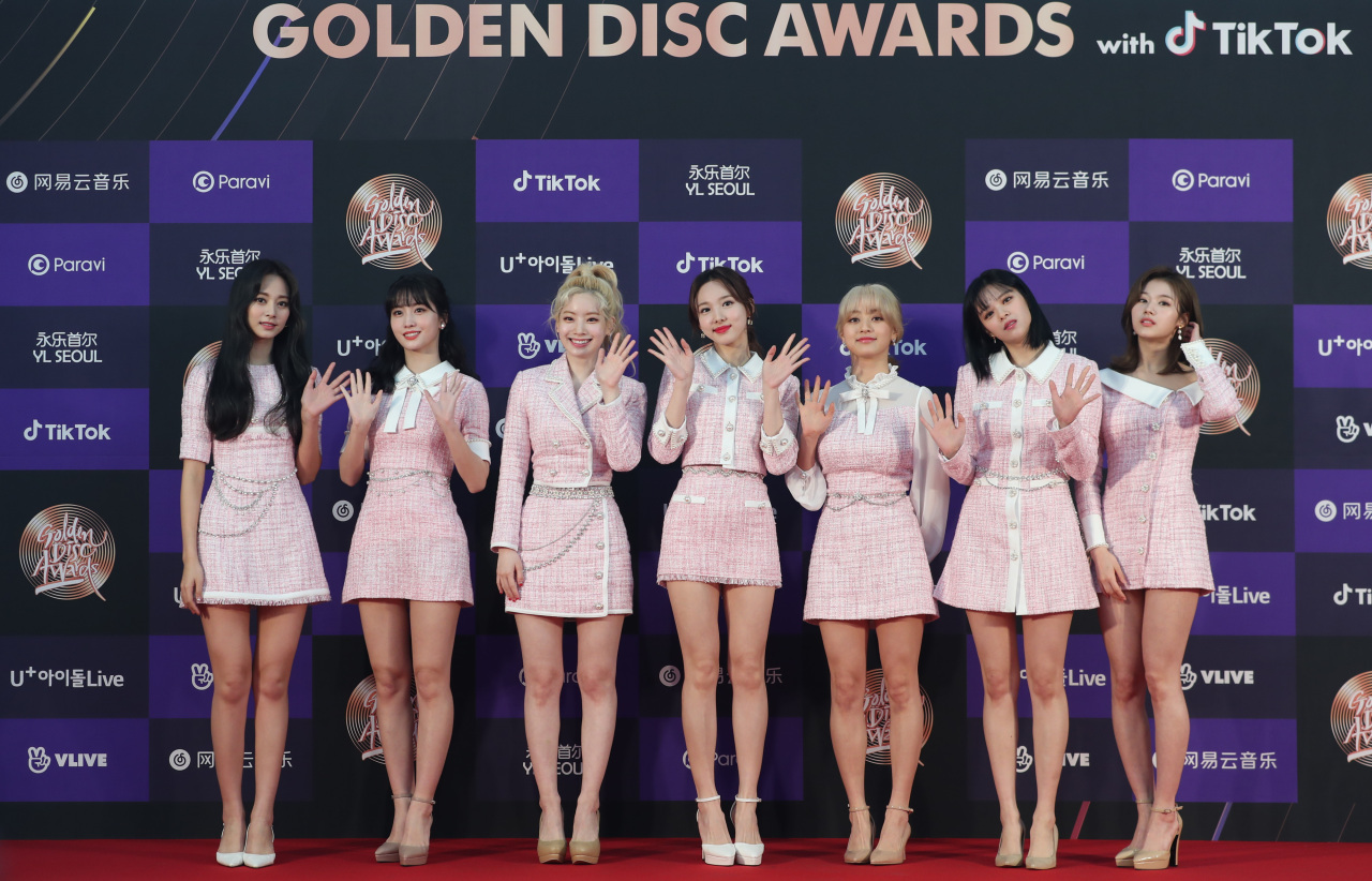 Members of Twice pose for photos at the 34th Golden Disc Awards ceremony in Seoul on Jan. 5. (Yonhap)