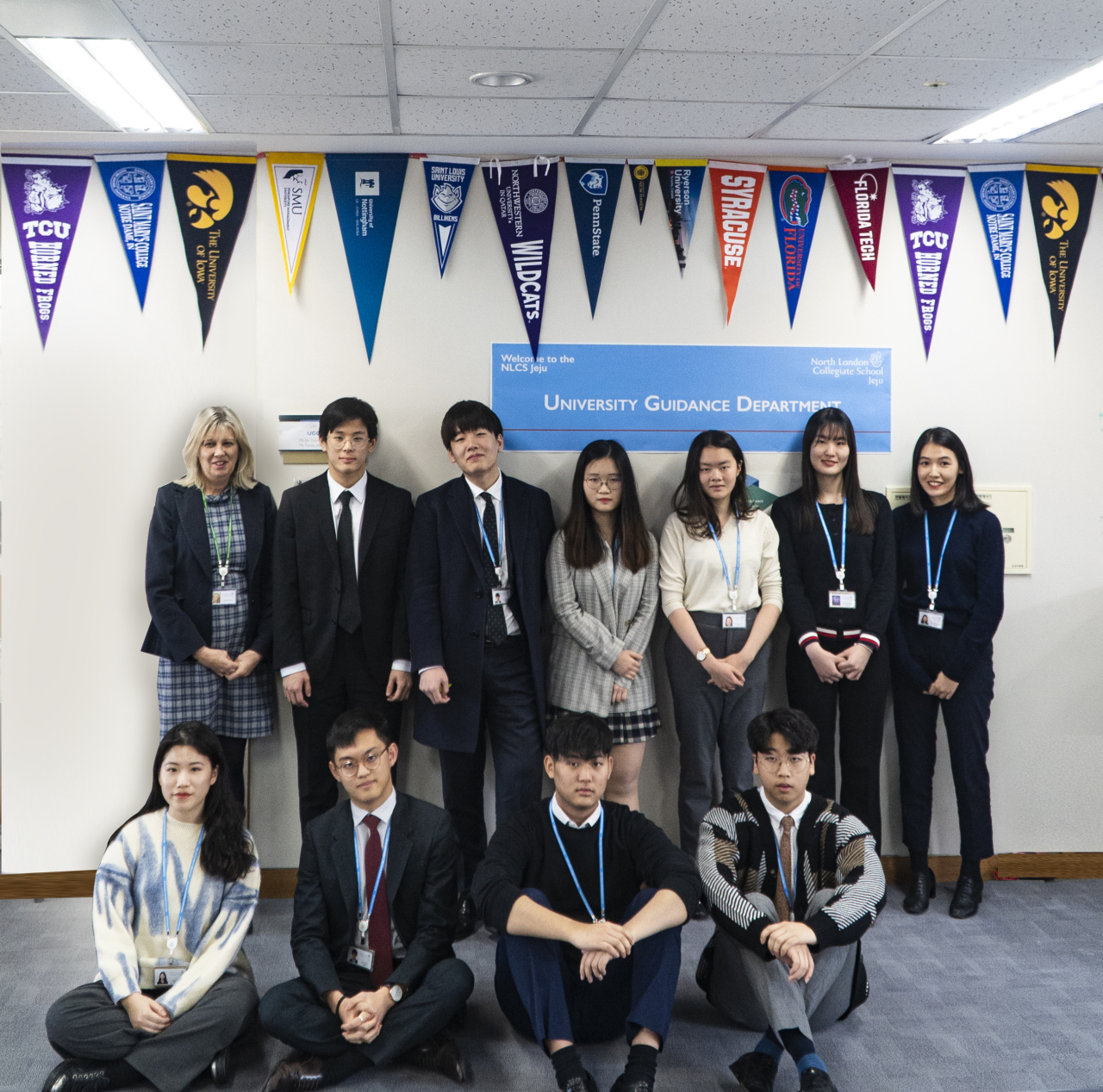Students who were accepted into Oxford University or Cambridge University this year, from North London Collegiate School Jeju, pose for a photo with Lynne Oldfield (first from left, back row), principal of the school. (NLCS Jeju)