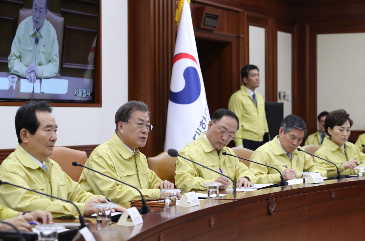 President Moon Jae-in speaks at the coronavirus response meeting at the government complex in Seoul on Thursday. Yonhap