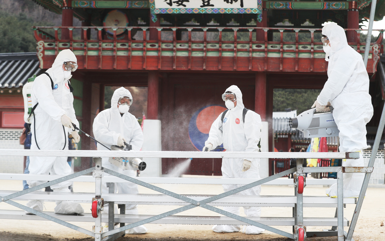Local health officials disinfect a Joseon era palace in Hwaseong, Gyeonggi Province, on Thursday afternoon. (Yonhap)