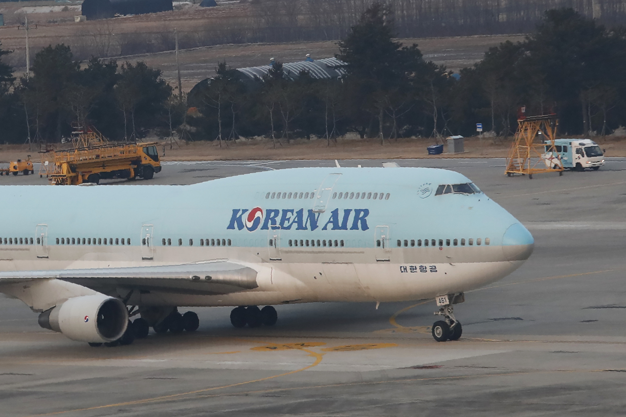 A South Korean chartered plane carrying evacuees from Wuhan, China, taxis after landing at Gimpo International Airport on Friday. Yonhap