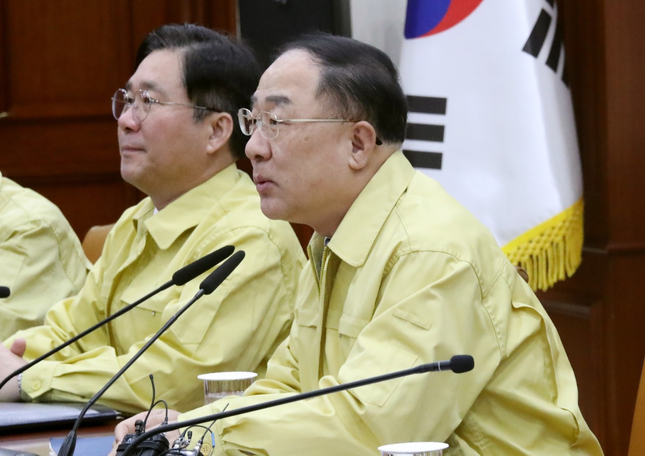 Deputy Prime Minister and Finance Minister Hong Nam-ki on Monday speaks in a ministerial meeting to respond to the spread of the novel coronavirus. (Yonhap)
