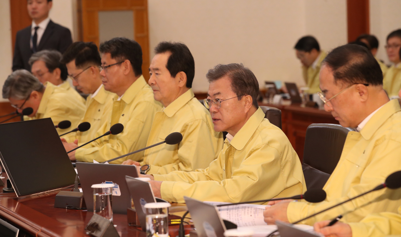 President Moon Jae-in and government ministers attend the Cabinet meeting on Tuesday. Yonhap