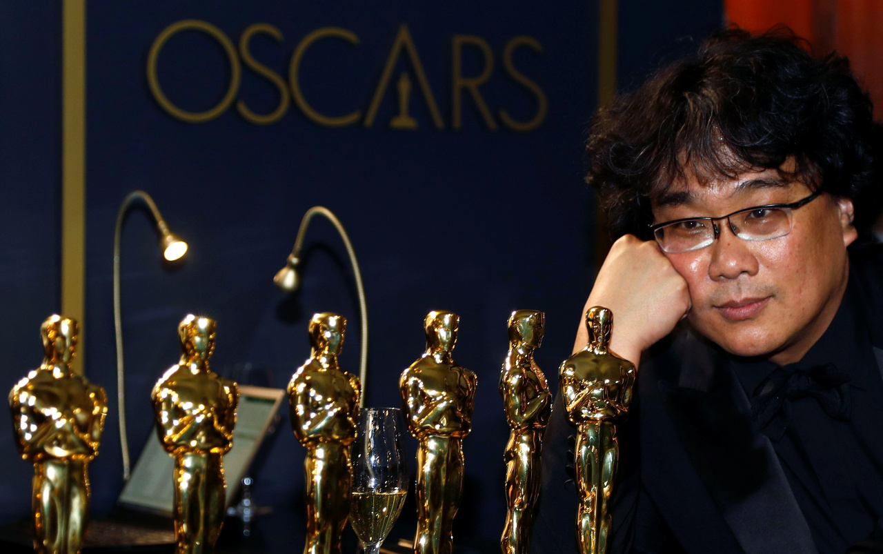 Bong Joon-ho poses with the Oscars for