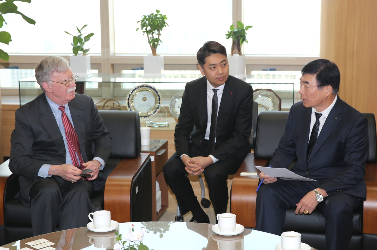 Rhone Group Senior Adviser John Bolton (left) speaks with Military Mutual Aid Association Chief Executive Kim Do-ho (third from left) in a meeting held in MMAA headquarters in Seoul Monday. (MMAA)