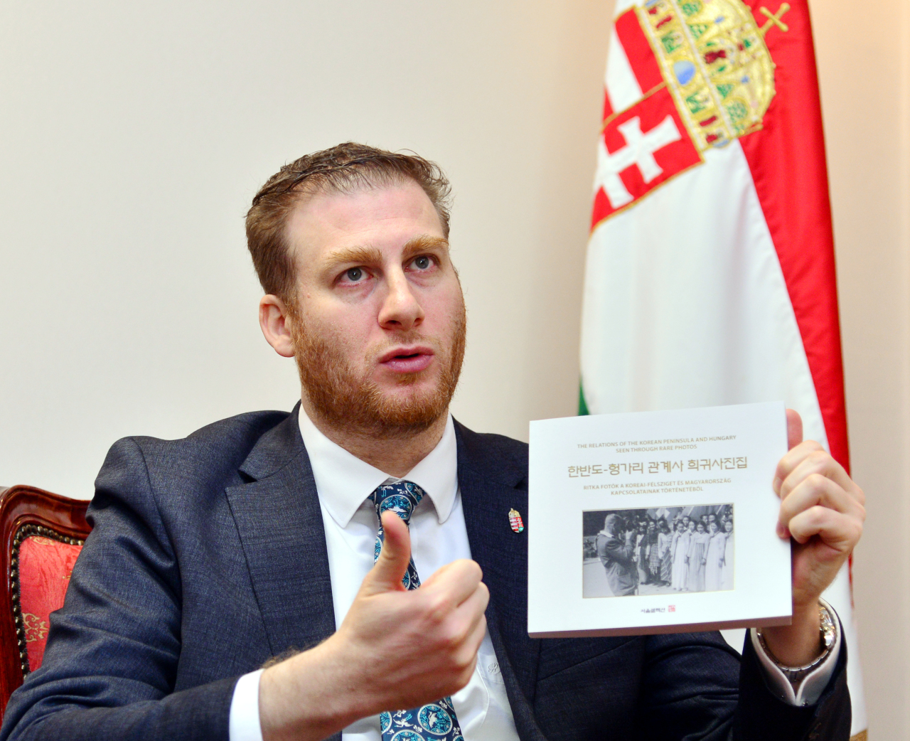 Hungarian Ambassador to Seoul Mozes Csoma introduces his photo book on Korea-Hungary historic ties in an interview with The Korea Herald at the embassy in central Seoul on Feb. 7. (Park Hyun-koo/ The Korea Herald)
