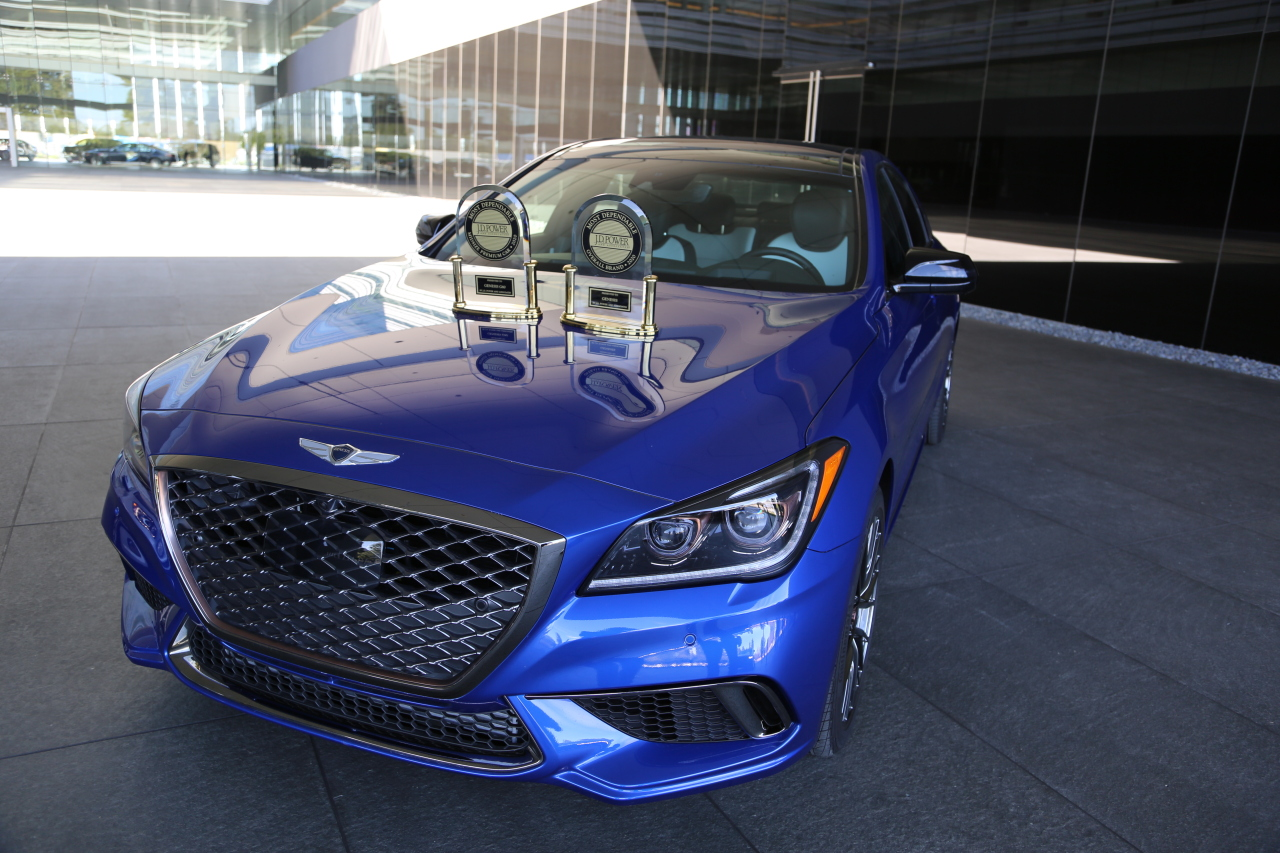 Two trophies from J.D. Power are displayed on the hood of the Genesis G80 Sport. (Genesis)