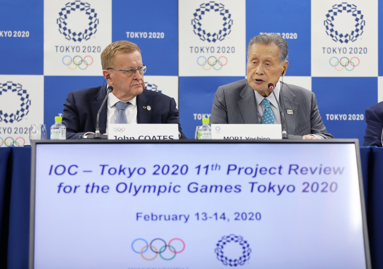 John Coates (left), chairman of International Olympic Committee (IOC) Coordination Commission for the Olympic Games Tokyo 2020, and Mori Yoshiro, president of Tokyo Organising Committee of the Olympic and Paralympic Games (Tokyo 2020), attend the IOC-Tokyo 2020 joint press conference for the 11th Project Review meeting between the IOC and Tokyo 2020 in Tokyo on Friday.(Xinhua-Yonhap)