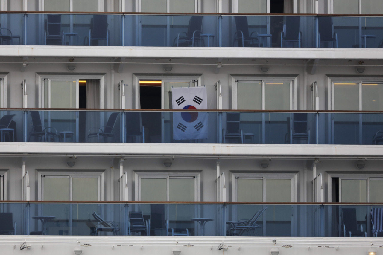 A South Korean flag hangs outside a cabin of the quarantined Diamond Princess cruise ship at the Yokohama port in Japan. (AP-Yonhap)