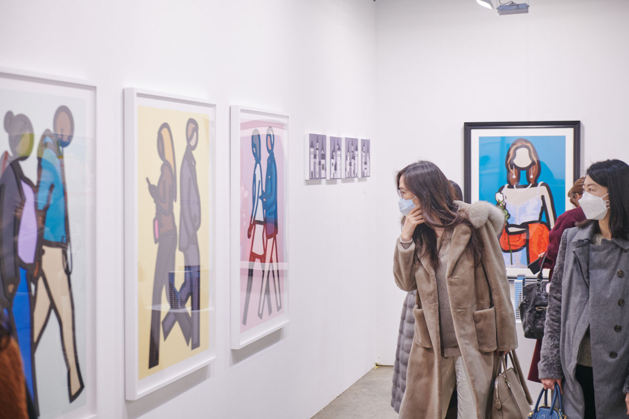 Visitors wearing face masks look at works on display at Galleries Art Fair 2020, which runs Thursday to Sunday in Seoul. (Galleries Association of Korea)