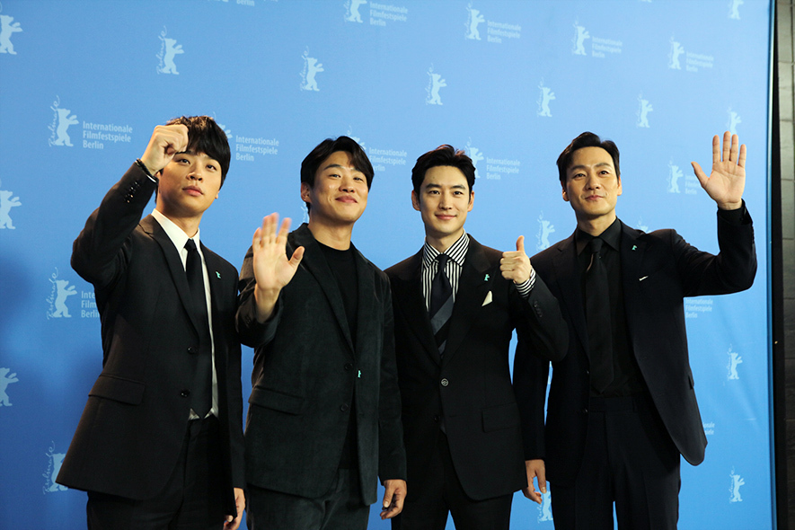 "Cast members of ""Time to Hunt,"" Park Jeong-min (from left), Ahn Jae-hong, Lee Je-hoon and Park Hae-soo, arrive at the 70th Berlin International Film Festival in Berlin, Germany, on Saturday. (Little Big Pictures)"
