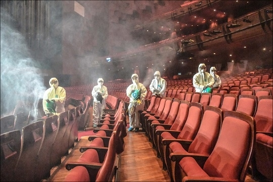 Workers wearing protective gear at Sejong Center disinfect the concert hall. (Sejong Center)