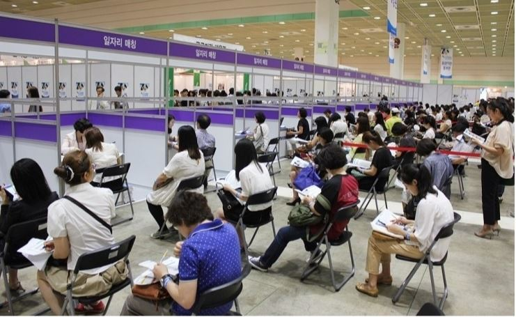 Applicants for temporary jobs, offered by the public sector, sit in rows during a job fair in Seoul. (Ministry of Employment and Labor