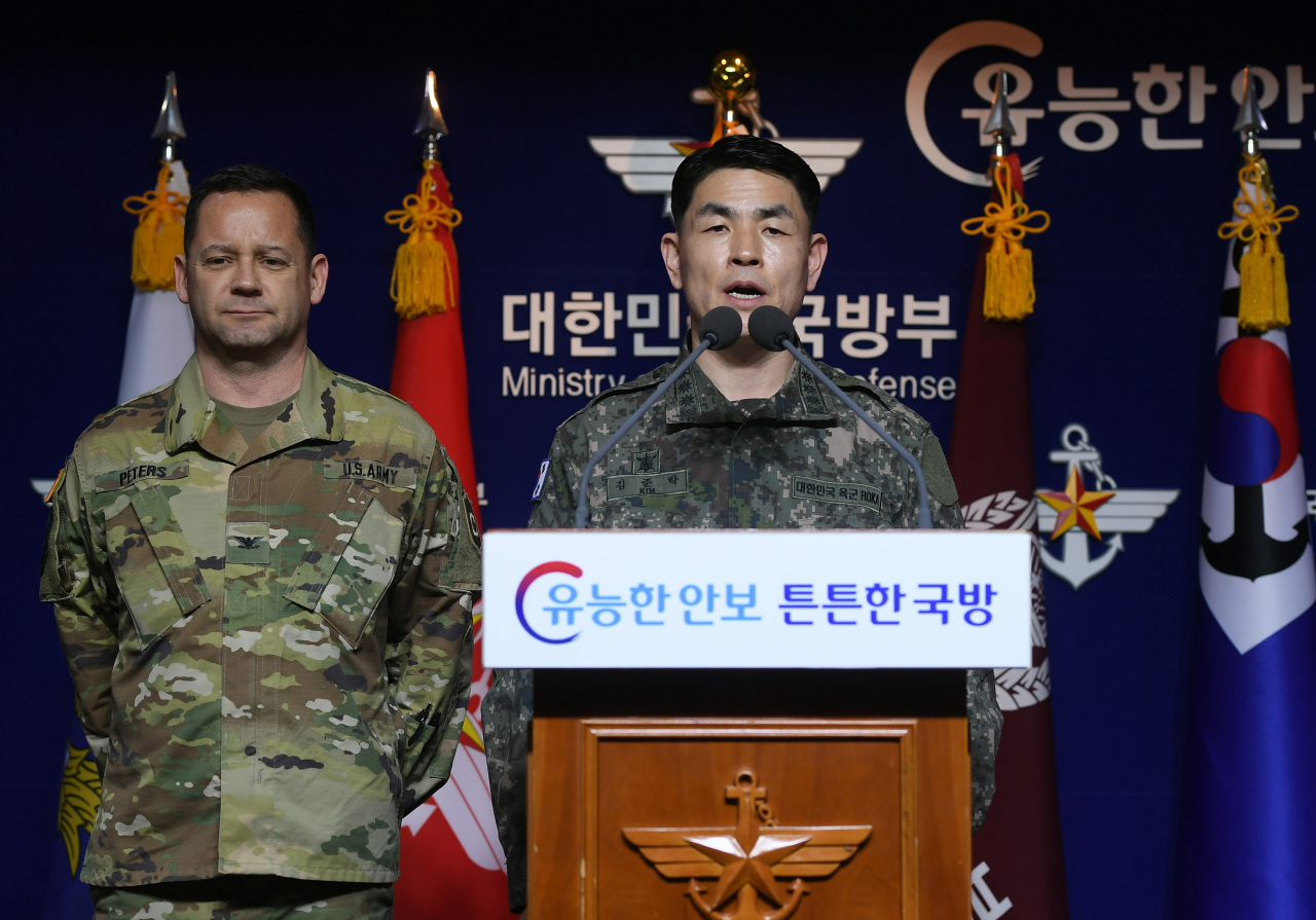 Col. Kim Jun-rak, a spokesman at the South Korean Joint Chiefs of Staff, announces Thursday at Seoul's Defense Ministry that ROK-US joint military exercises will be put off until further notice for the safety of all service members. (Yonhap)