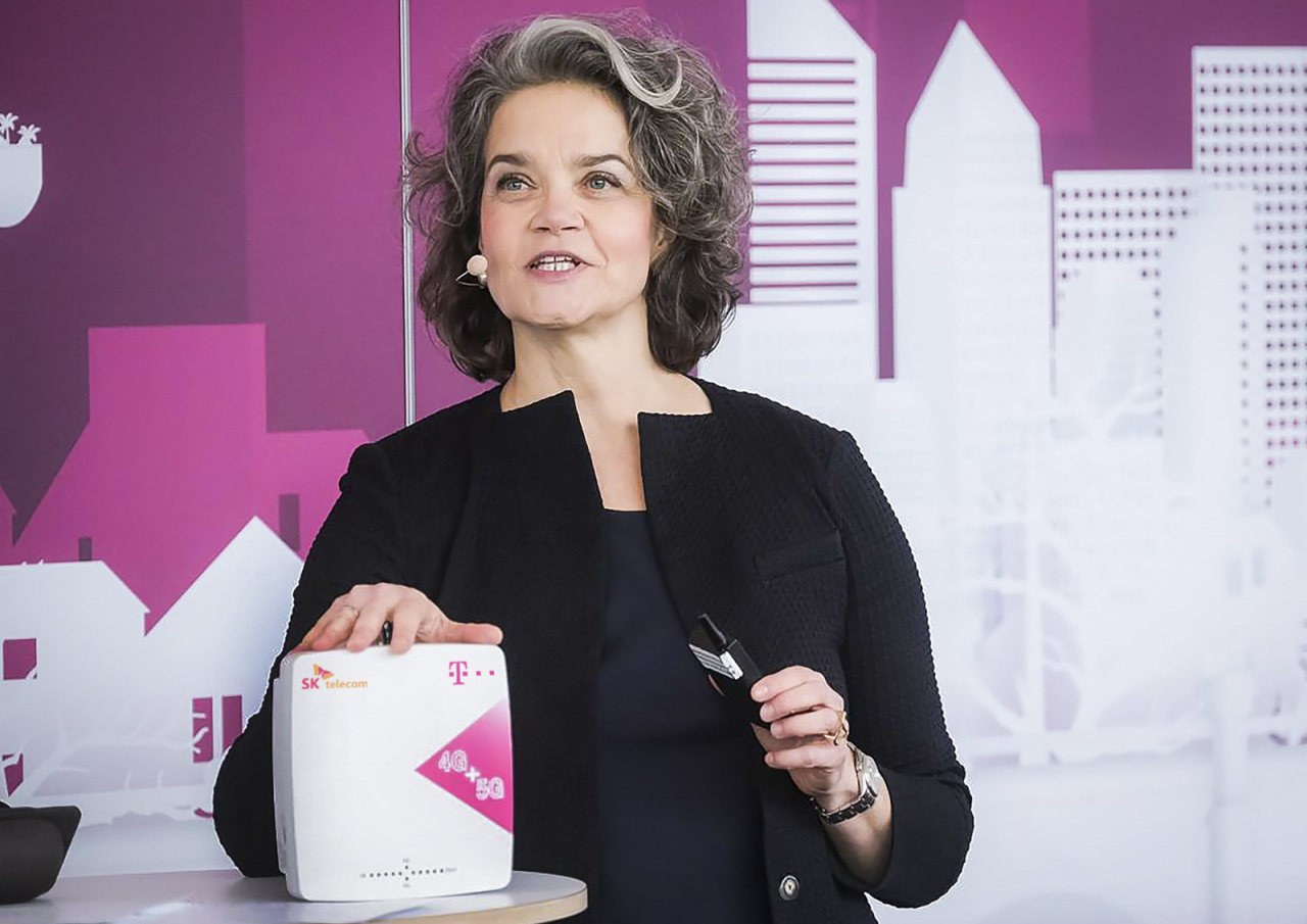 Claudia Nemat, a board member for technology and innovation at Deutsche Telekom, presents its high-performance 5G and 4G repeater in collaboration with South Korean mobile carrier SK Telecom, in Bonn, Germany, Wednesday. (SK Telecom)