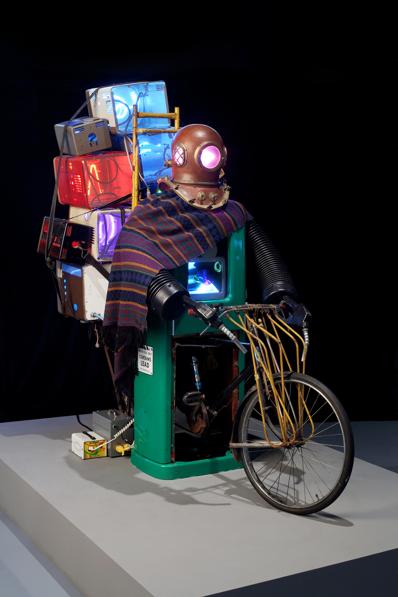 """Paik Nam-june's """"The Rehabilitation of Genghis-Khan"""" (1993) at Nam June Paik Art Center. Genghis-Khan riding a bike with television sets suggests a new era of software development. The robot sculpture was produced for the Venice Biennale in 1993. (Nam June Paik Art Center)"""